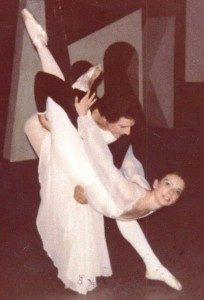 Sheila practicing with her partner during her professional ballet career.