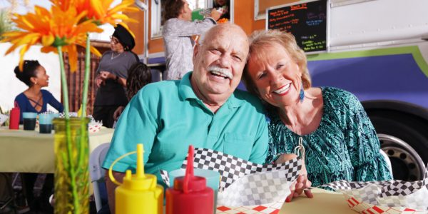 older couple on date - food truck